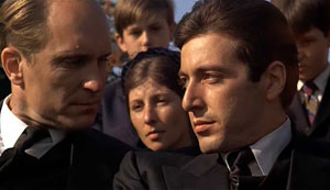 Robert Duvall as Tom Hagen (left) and Al Pacino as Michael Corleone (right)