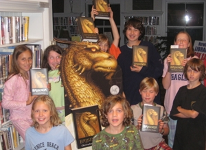 In addition to midnight parties held at bookstores, many libraries joined in the fun as well. The Norwich Public Library in Norwich, Vt., hosted a read-a-thon last Friday night for fourth- to eighth-graders, to celebrate the release of Brisingr. At midnight, the kids received their pre-ordered copies from Norwich Bookstore across the street, and got to stay up all night at the library, reading.